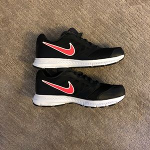 Black and pink women's Nike shoes